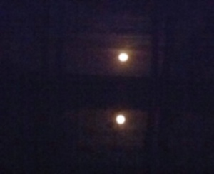 Sister Moon and her water-twin at 5:35 a.m.